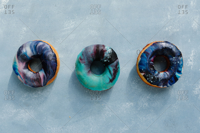 Overhead shot of donuts with galactic sugar glaze