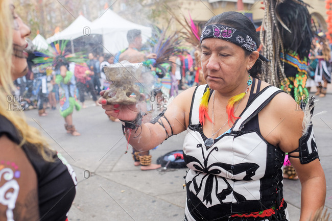 Oakland, California, USA - October 29, 2017: Person burning incense at Day of the Dead festival