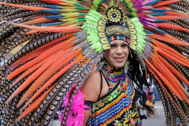Oakland, California, USA - October 29, 2017: Smiling woman wearing elaborate traditional native headdress at Day of the Dead festival