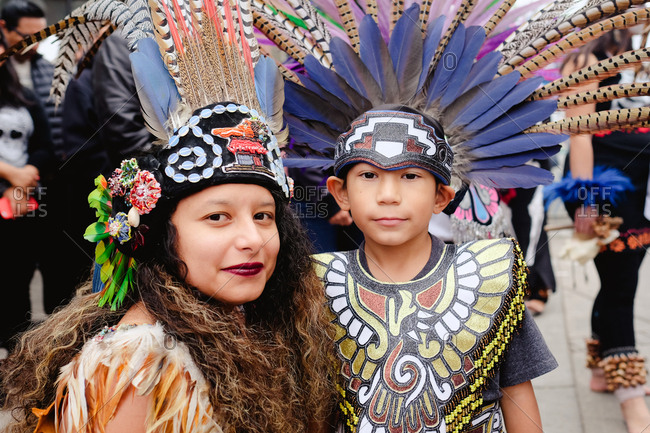 Oakland, California, USA - October 29, 2017: Woman and boy wearing traditional native costume at Day of the Dead festival