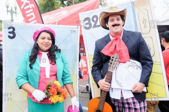 Oakland, California, USA - October 29, 2017: Couple wearing costumes depicting loteria cards at Day of the Dead festival