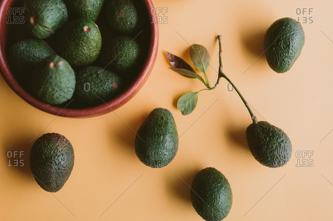 Green avocados arranged in a pattern