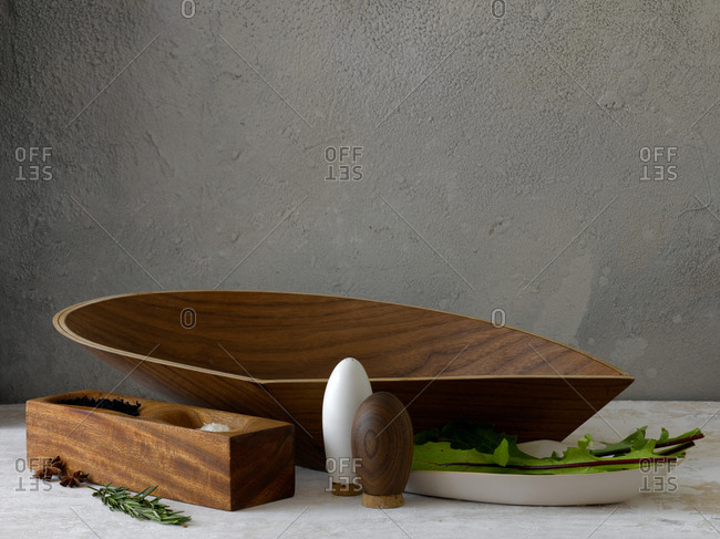 Studio shot of large wooden serving arranged with accessories