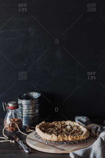 Fresh baked pie cooling on rack against dark background