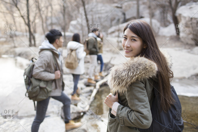 Portrait of cheerful young Chinese woman outdoors in winter