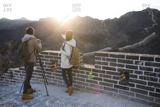 Young Chinese couple photographing on the Great Wall