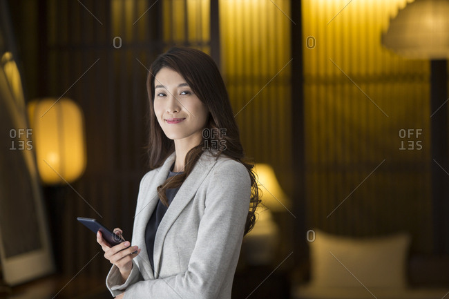 Cheerful young Chinese businesswoman