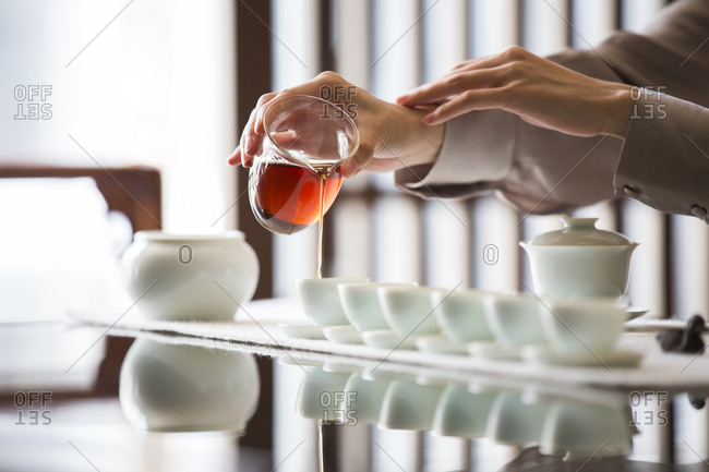 Young Chinese woman performing tea ceremony