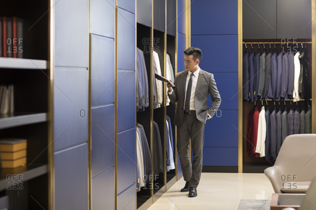 Chinese businessman shopping in a men's wear store