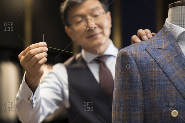 Confident Chinese fashion designer working
