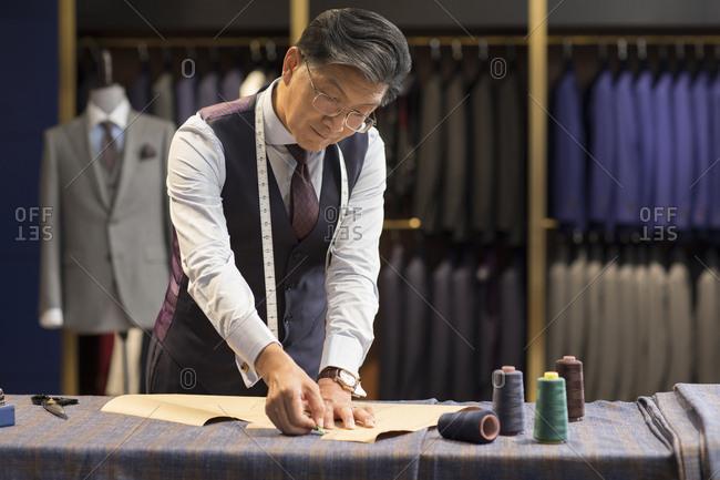 Confident Chinese fashion designer working