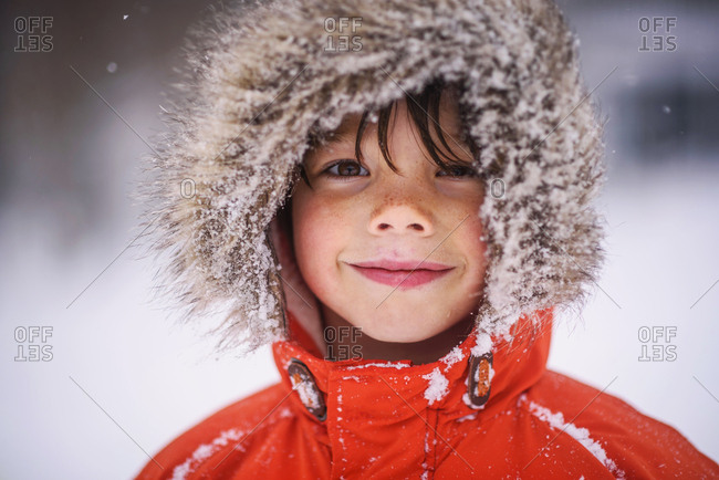 Portrait of a happy young boy bundled up in the winter
