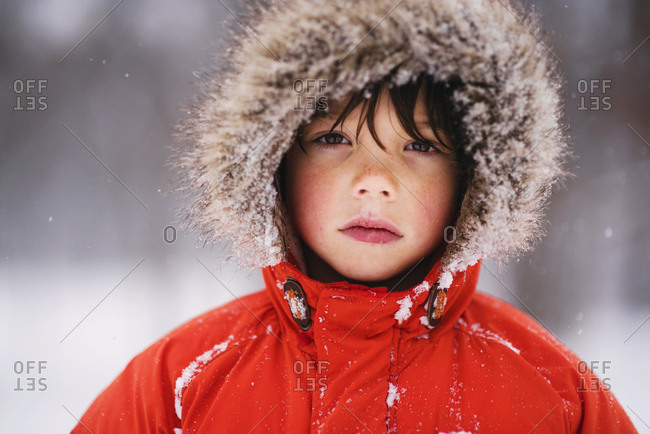 Portrait of a young boy bundled up in the winter