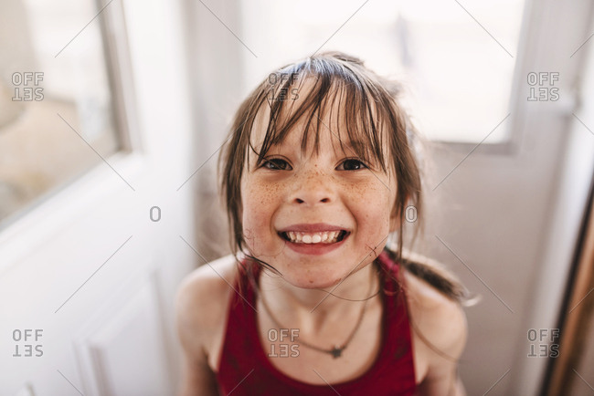 Portrait of a young girl after playing in the mud