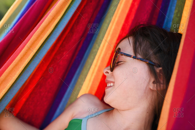 Brunette girl smiling in hammock
