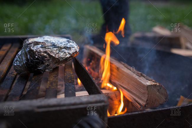 Food in aluminum foil on a bonfire