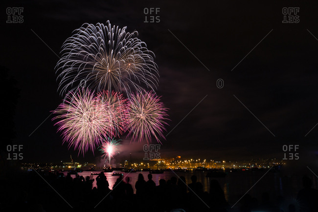 Colorful fireworks over water