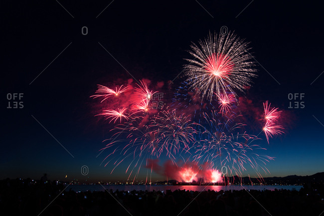 Bright fireworks over water