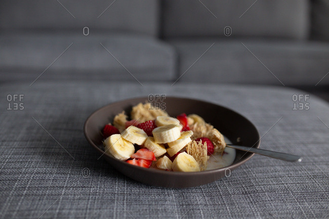 Bowl of shredded wheat cereal with fruit