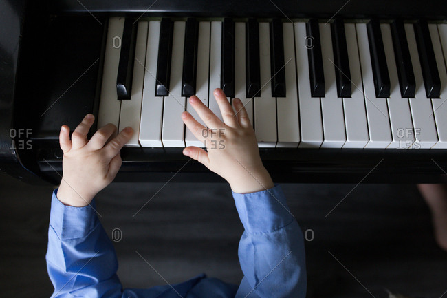 Baby's hands on a piano