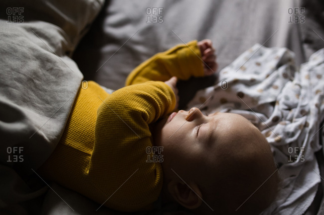 Close up of baby sleeping on bed