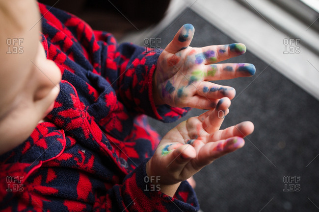 Toddler's hands covered in marker stains