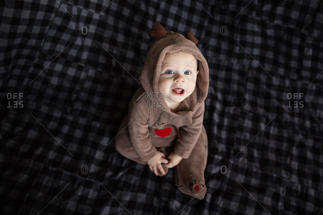 Baby wearing reindeer outfit