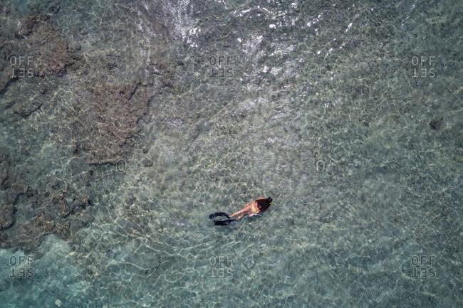 Aerial view of woman snorkeling in sea