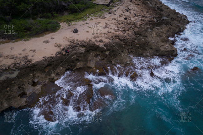 Aerial of rocky coast along the turquoise sea