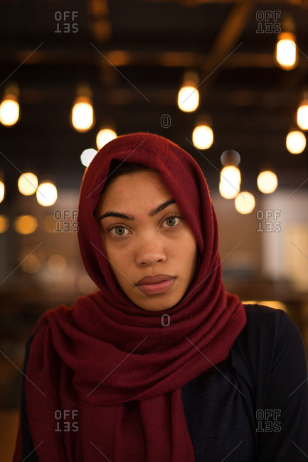 Portrait of businesswoman in hijab at cafeteria