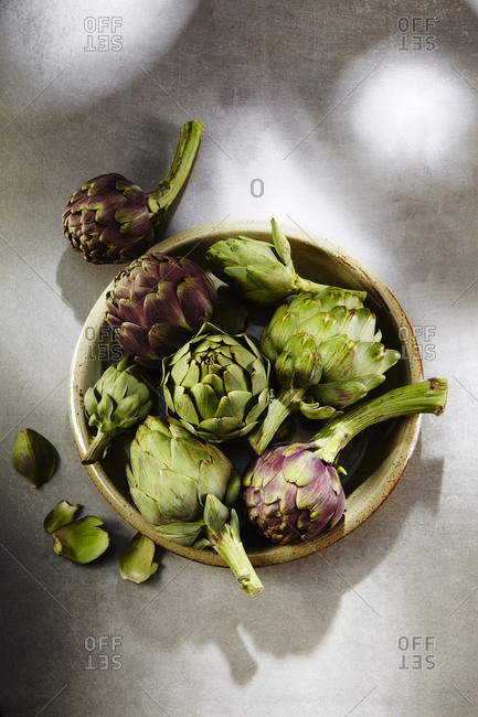 Top view of bowl of whole artichokes