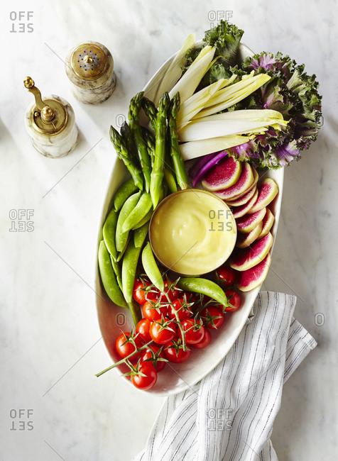 Vegetable platter with aioli dip and seasoning