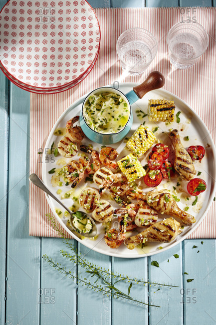 Festive chicken and seafood picnic platter with corn-on-the cob