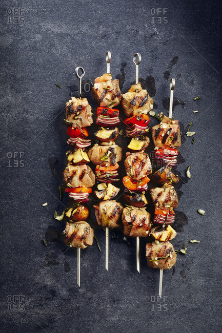 Four beef kabobs on skewers