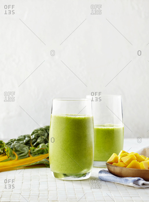 Fresh homemade smoothies with chard and mango