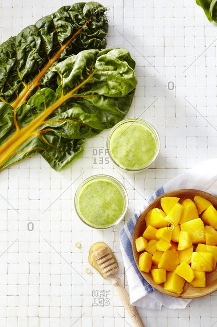 Top view of chard and mango smoothies