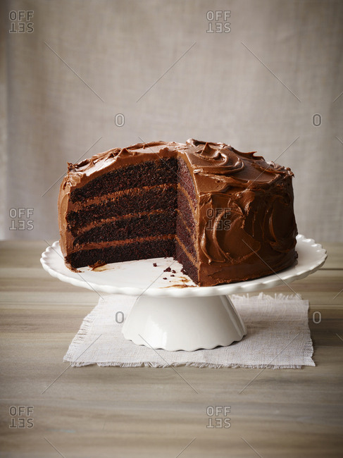 Chocolate cake with icing on a pedestal
