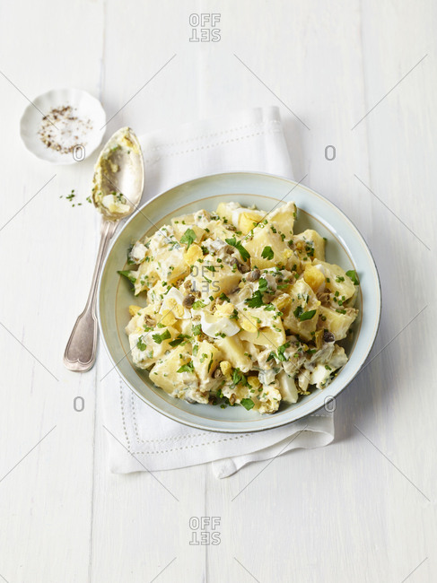 Picnic spread of creamy potato salad on bright wooden table
