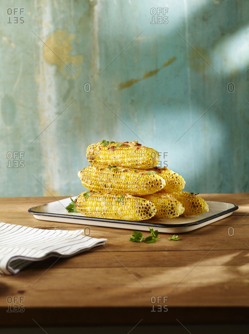 A plate of grilled corn with chipotle butter