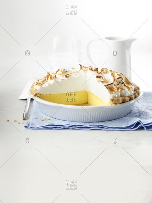 Sliced lemon meringue pie on traditional linen napkin