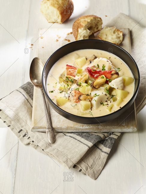 Nova Scotia seafood chowder in a bowl with bread