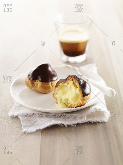 Profiteroles on a plate with espresso drink