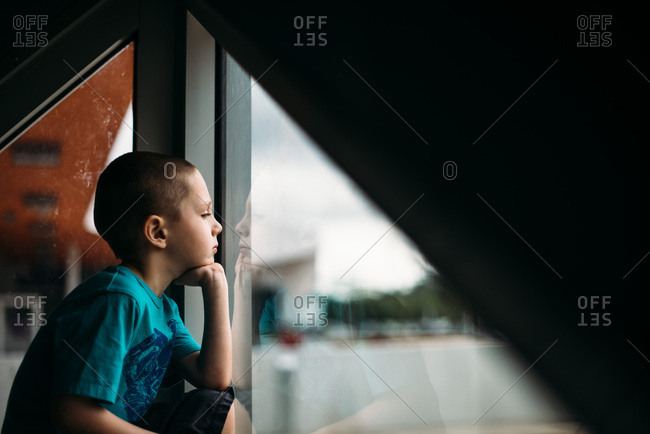 Boy gazing out a window