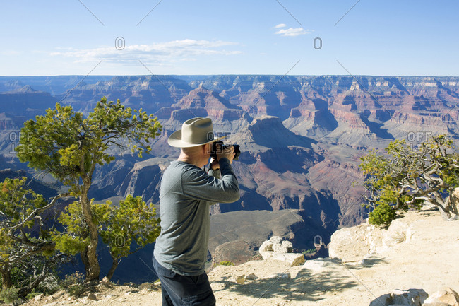 Man photographing the Grand Canyon