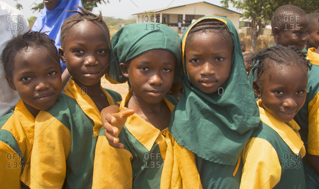 Taiama, Sierra Leone - February 15, 2013: Smiling school children in uniforms going to school