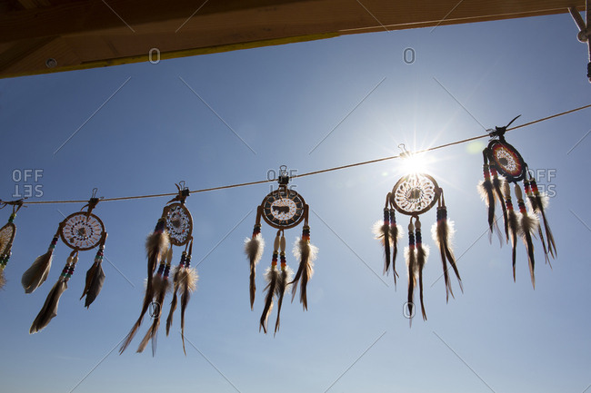 American Indian dreamcatchers for sale at roadside stand at sunrise in Arizona