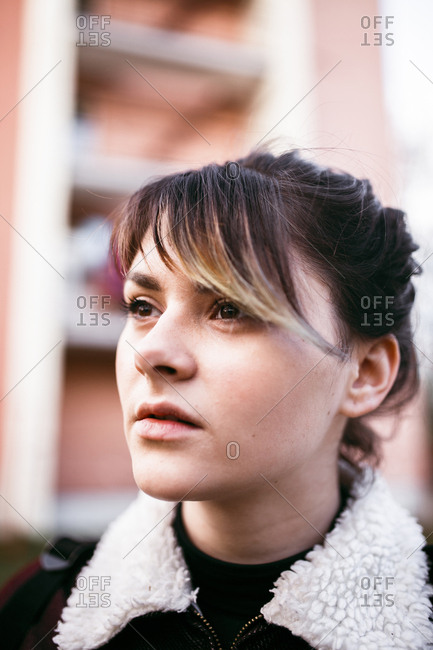 Close-up of thoughtful young woman looking away in city