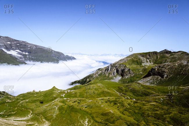 Idyllic view of mountain ranges by clouds against sky