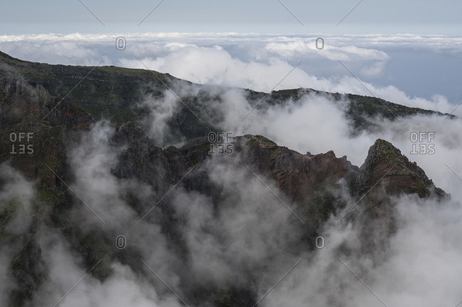 View above the clouds and peaks near Pico do Areeiro