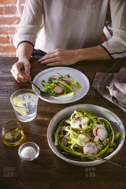 Woman eating asparagus salad